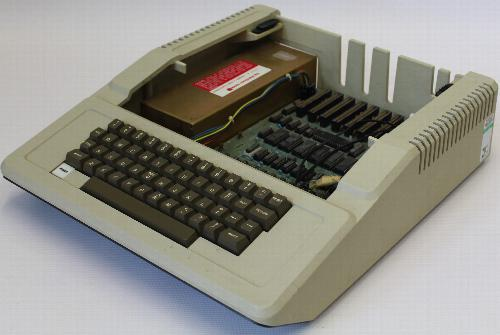 Apple II Europlus with the casing open to show board and expansion slots